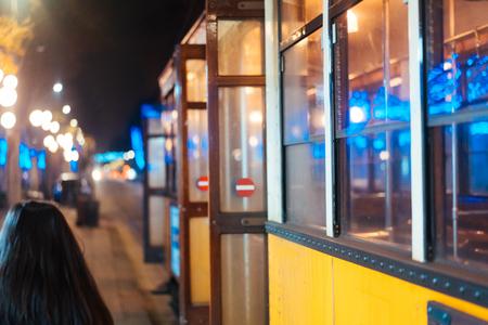 tram on the night street 写真素材