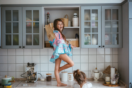 two little girls are looking for cookies