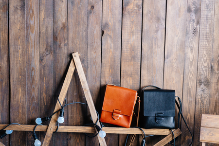 two leather bags on a wooden background