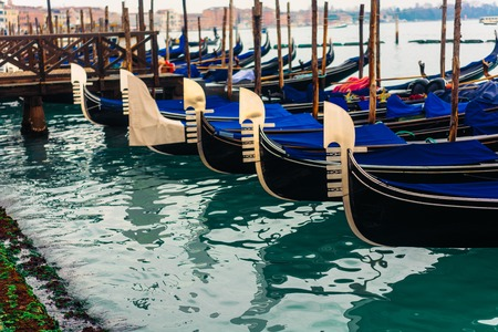 Rows of traditional wooden gondolas Stock Photo