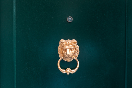 Decorative gilded lion head door knob, close view. Stock Photo