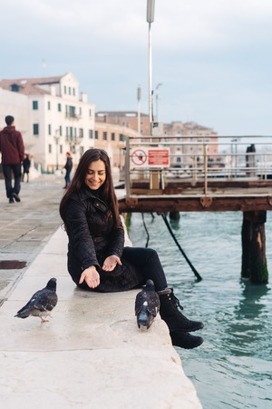 Girl sitting on the edge of the Grand Canal