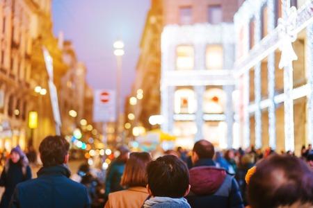 people crowd walking on busy street Stock Photo