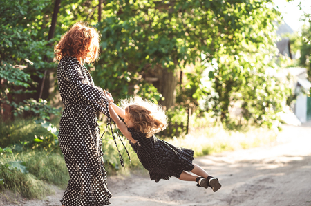 Mom and little daughter are having fun and playing