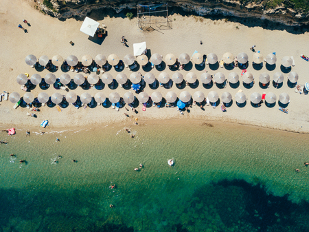 Beach with sun beds, view from above
