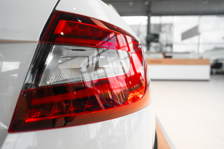 The rear lights of a modern prestigious car from a close angle 스톡 콘텐츠