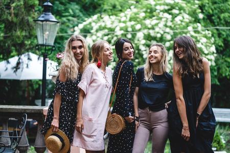 Five girls posing on camera