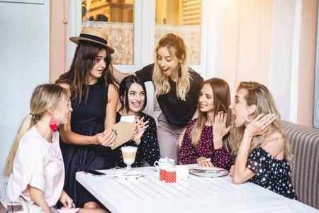 Six girls at the table Фото со стока