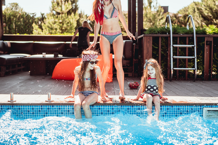 Happy mother and two daughters have fun Banque d'images