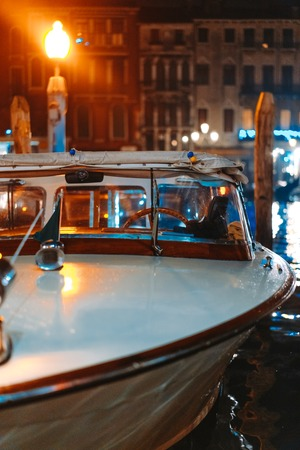 Small boat at night channel Stock Photo