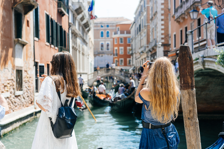 Two young girls stand on the gondola service