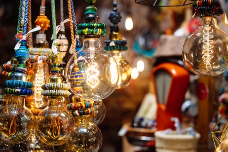 The store is decorated with electric light bulbs Stock Photo - 113091612