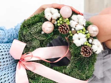 Young woman holding a Christmas wreath