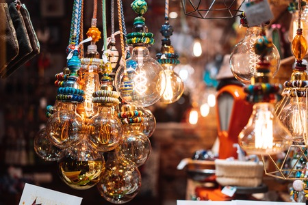 The store is decorated with electric light bulbs Stock Photo - 113089248
