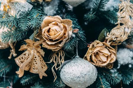 Christmas silver ball on branch at Christmas tree. Stock Photo