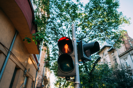 Urban, street traffic lights. The red sign for pedestrians is lit. Archivio Fotografico - 113302114