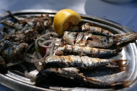 On the oval metal dish lies the fried fish. Reklamní fotografie