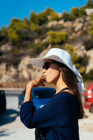 A young slender woman with a big white hat in summer Stock Photo
