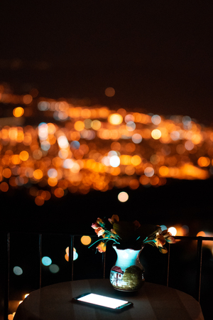 Image of wood table and blurred city bokeh background with colorful lights. Banco de Imagens