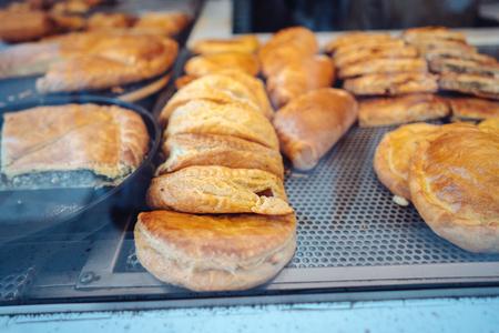 Fresh bakery in showcase of a street shop bakery food. Фото со стока