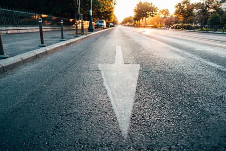 Arrow signs as road markings on a street Stockfoto - 113837678