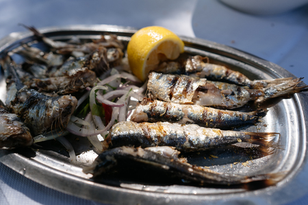On the oval metal dish lies the fried fish. Banco de Imagens