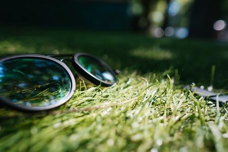 Sunglasses lie on the grass, close angle