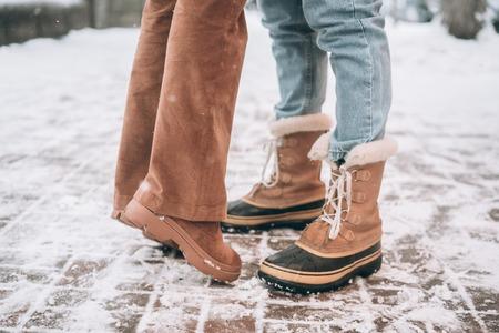 boyfriend and girlfriend posing for the camera, legs only Reklamní fotografie