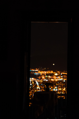 Glowing lights the Greek city from the window of the hotel Reklamní fotografie