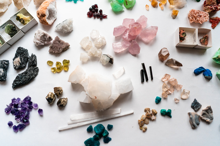 Collection of beautiful precious stones on white table. Archivio Fotografico