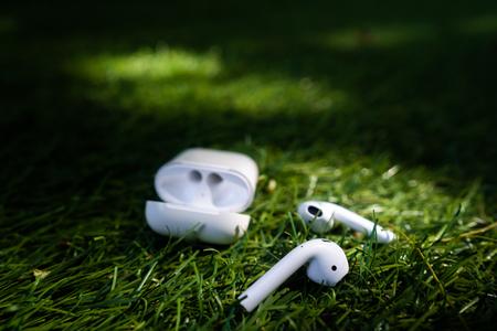 Wireless headphones lie on the grass, close angle Stok Fotoğraf