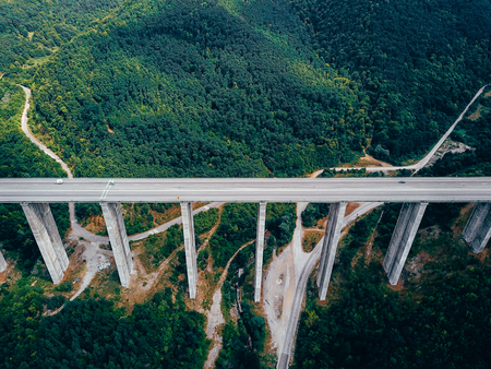 Aerial view of the road in the mountains over the bridge