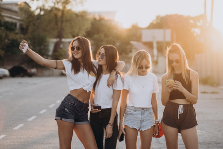 Four young women taking a selfie and have fun