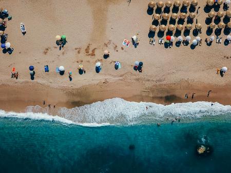 Beach with sun loungers on the coast of the ocean Stock Photo