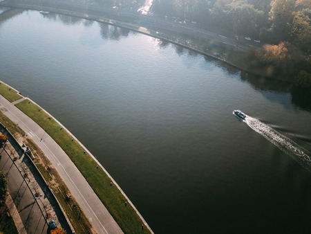 Motor boat floats down the river Wisla