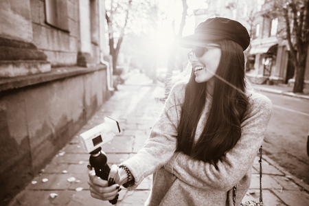 Cute, young female blogger posing on camera. Imagens