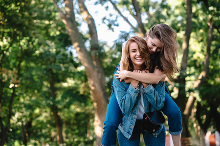 Beautiful women having fun in the park. Friends and summer concept. Stock Photo