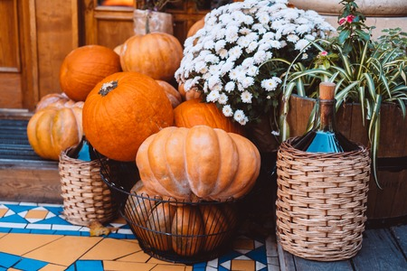Autumn decoration with pumpkins and flowers at a flower shop on a street in a European city Фото со стока - 120737736