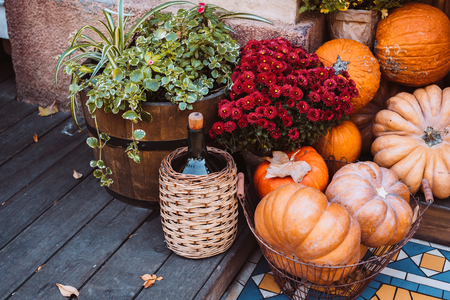 Autumn decoration with pumpkins and flowers at a flower shop on a street in a European city Stock Photo
