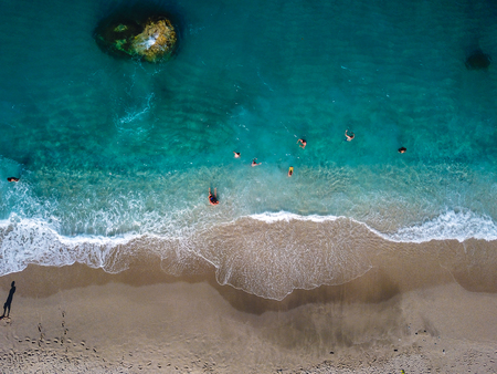 Aerial View From Flying Drone Of People Relaxing