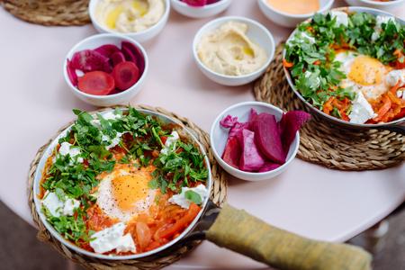 Shakshuka, Fried Eggs in Tomato Sauce on the Table
