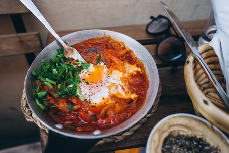 Shakshuka, Fried Eggs in Tomato Sauce on the Table