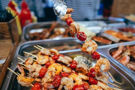 Delicious shrimp and tomato shashlik, close view