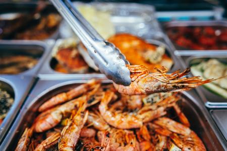 tray with many fried shrimp in the street restaurant Stock Photo - 123209230