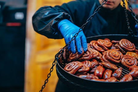 Two tier grill with delicious spiral sausages Stock Photo - 123209359