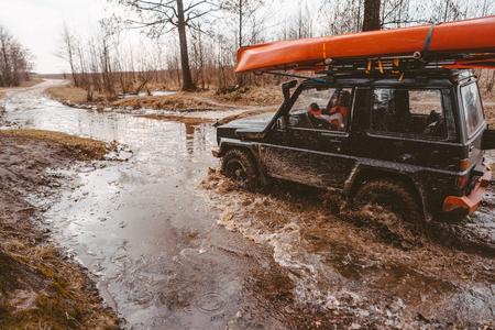 Off-road travel on dirt road road, water splash.