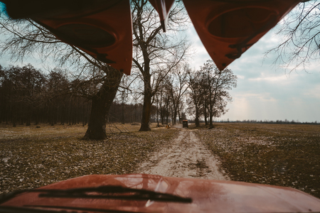 SUV driving on a dirt road view through the windshield Stock fotó