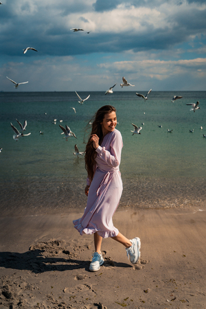 Beautiful unusual woman walking on the beach Stock Photo - 123211762