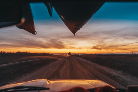 SUV driving on a dirt road view through the windshield Stock Photo
