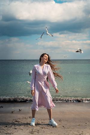 Beautiful unusual woman walking on the beach